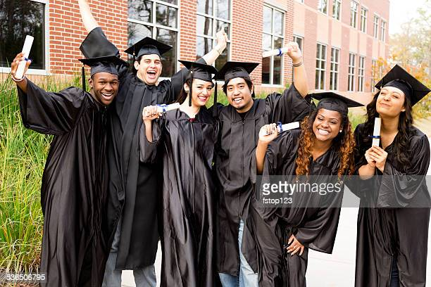 education: diverse group of friends excited after college graduation. diplomas. - high school graduation stock pictures, royalty-free photos & images