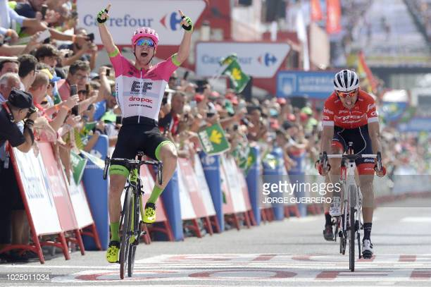 Education FirstDrapac's Australian cyclist Simon Clarke celebrates as he crosses first the finish line followed by TrekSegafredo's Dutch cyclist...