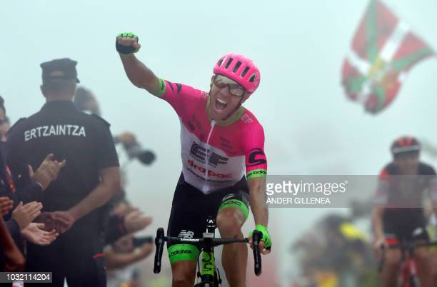 Education First's Canadian cyclist Michael Woods celebrates as he wins the 17th stage of the 73rd edition of La Vuelta Tour of Spain cycling race a...