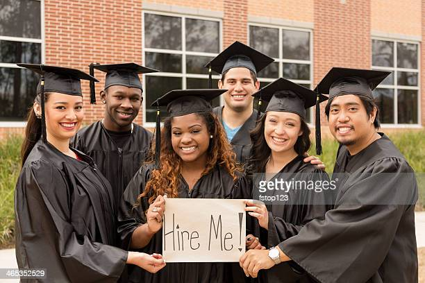 Education: Friends hold 'Hire Me' sign after college graduation.