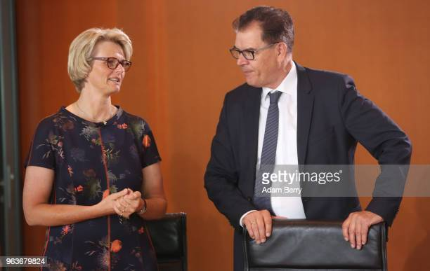 Education Minister Anja Karliczek speaks to Minister for Economic Cooperation and Development Gerd Mueller as they arrive for the weekly German...