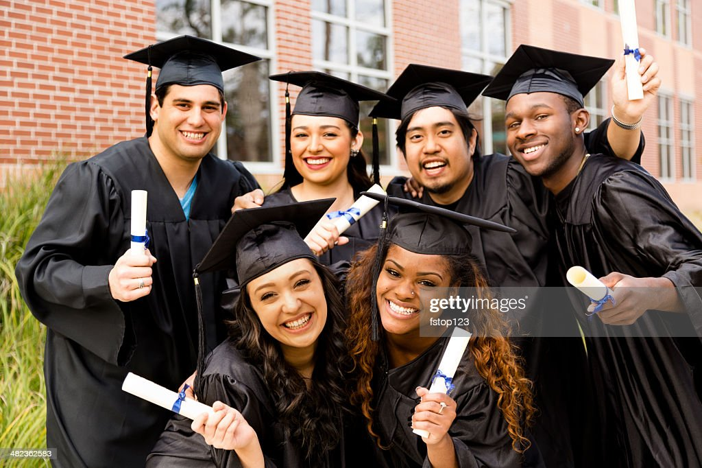 Education: Multi-ethnic friends excitedly hold diplomas after college graduation. : Stock Photo