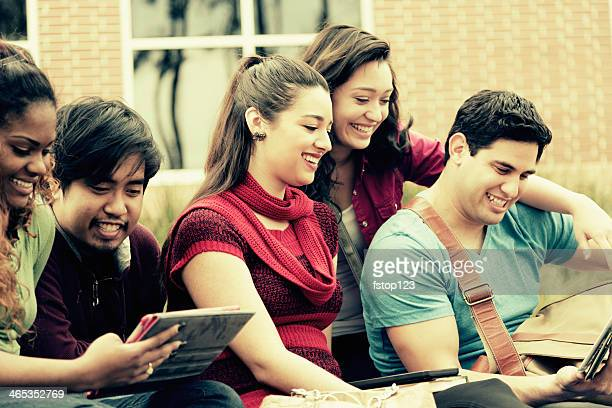Education: Multi-ethnic group of college students hang out. Digital tablets.