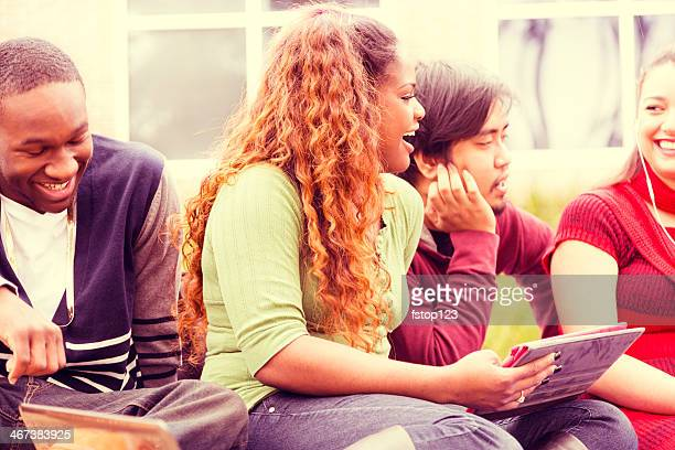 Education: Multi-ethnic group of college students hang out. Digital tablet.