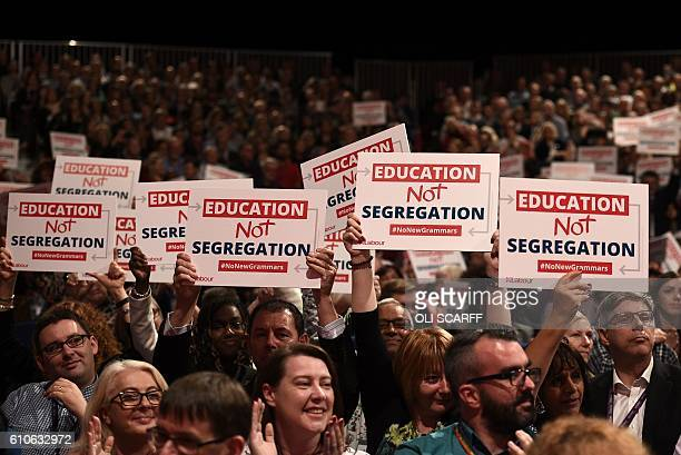 'Education Not Segregation' placards are held up in the audience as British Shadow Education Secretary Angela Rayner speaks on the third day of...