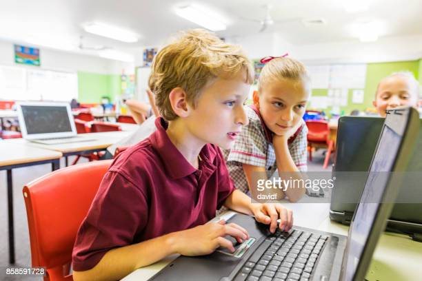 education of primary school students using computers - state school stock pictures, royalty-free photos & images