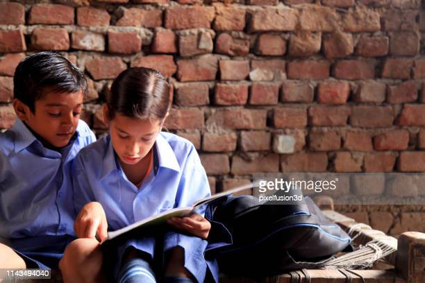 education! - village stock pictures, royalty-free photos & images