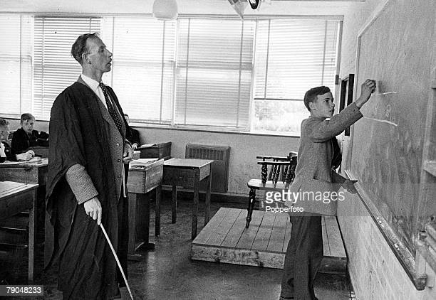 Education Public Schools Magdalen College School Cambridge Undated file picture A pupil works out a problem on the blackboard watched by a...