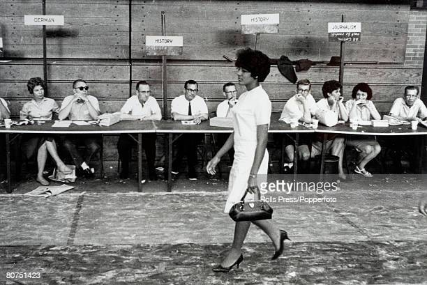 June 1963 Tuscaloosa Alabama USA Black student Vivian Malone is the centre of attention as she walks past the registration desks at the University of...