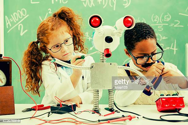 Education:  Retro revival children making robot in science lab.