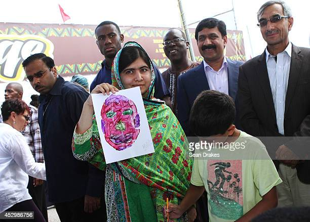 Education rights activist and Nobel Peace Prize nominee Malala Yousafzai of Pakistan displays her painting at a children's workshops at Emancipation...