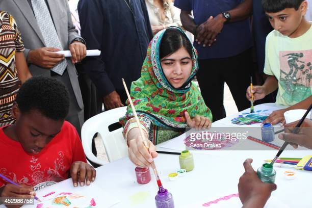 Education rights activist and Nobel Peace Prize nominee Malala Yousafzai paints with children at a children's workshops at Emancipation Village on...