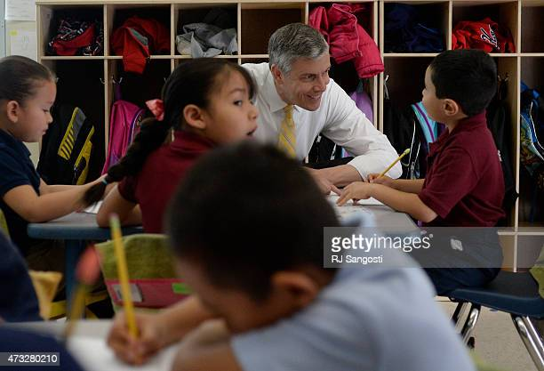 Education Secretary Arne Duncan visits a Kindergarten class at McGlone Elementary School in Denver May 14 2015 Duncan is in the Denver area to...