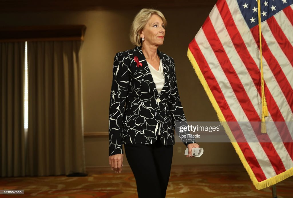 U.S. Education Secretary Betsy DeVos arrives for a news conference held at the Heron Bay Marriott about her visit to Marjory Stoneman Douglas High School in Parkland on March 7, 2018 in Coral Springs, Florida. DeVos was visiting the high school following the February 14 shooting that killed 17 people.