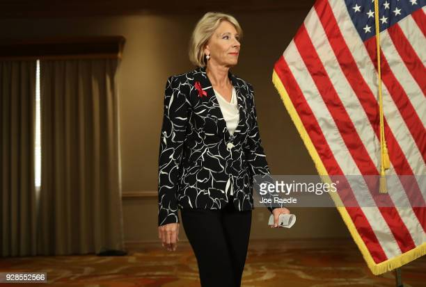 S Education Secretary Betsy DeVos arrives for a news conference held at the Heron Bay Marriott about her visit to Marjory Stoneman Douglas High...