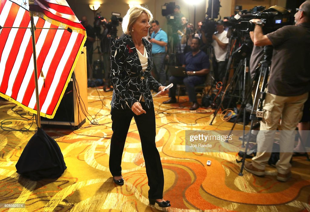 U.S. Education Secretary Betsy DeVos exits after speaking to the news during a press conference held at the Heron Bay Marriott about her visit to Marjory Stoneman Douglas High School in Parkland on March 7, 2018 in Coral Springs, Florida. DeVos was visiting the high school following the February 14 shooting that killed 17 people.