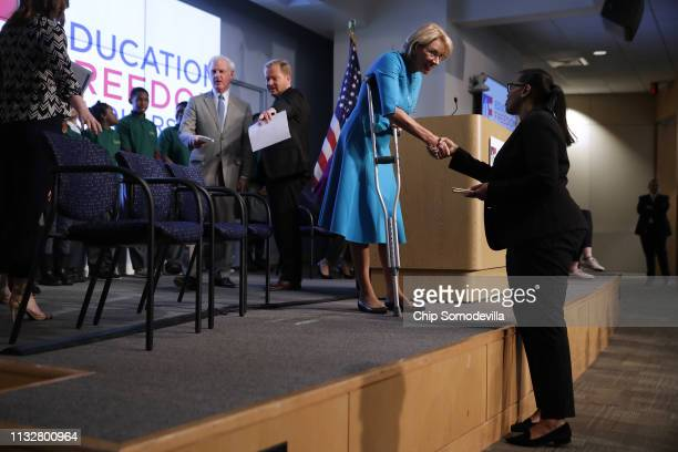 S Education Secretary Betsy DeVos greets Digital Pioneers Academy CEO and Principal Mashea Ashton before an event to promote the plan for Education...