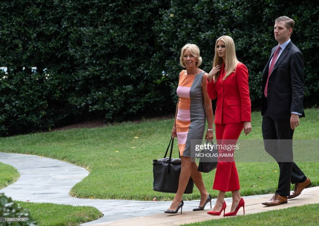 US Education Secretary Betsy DeVos (L), Ivanka Trump (C) and Eric Trump walk to board Marine One at the White House in Washington, DC, on July 31, 2018 as US President Donald Trump departs for Florida.