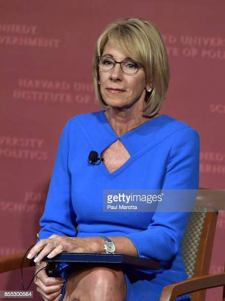 Education Secretary Betsy DeVos listens during the Harvard University John F Kennedy Jr Forum on 'A Conversation On Empowering Parents' moderated by...