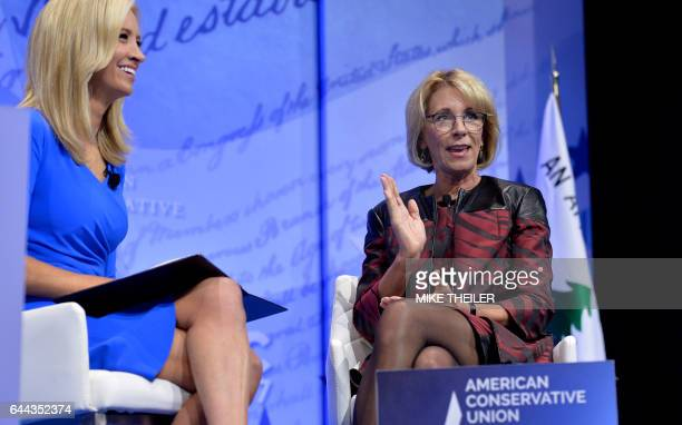 Education Secretary Betsy DeVos makes remarks as moderator Kayleigh McEnany listens during a discussion at the Conservative Political Action...