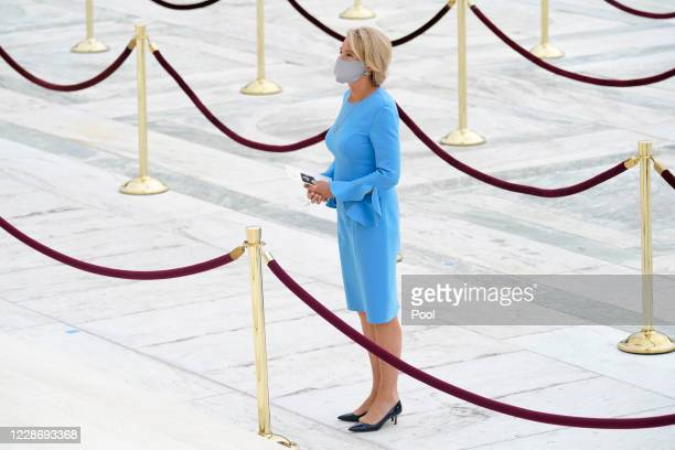 Education Secretary Betsy DeVos pays respects as Justice Ruth Bader Ginsburg lies in repose under the Portico at the top of the front steps of the...