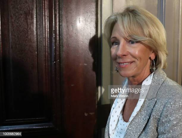 Education Secretary Betsy DeVos prepares to participate in a panel discussion on improving school safety In the Eisenhower Executive Office Building...