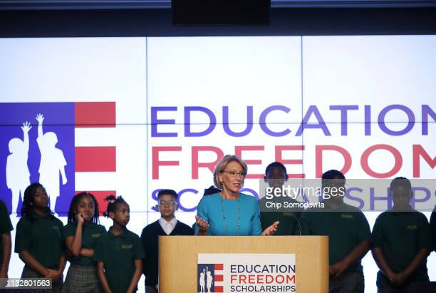 S Education Secretary Betsy DeVos stands in front of students from Digital Pioneers Academy during an event to discuss her proposal for Education...