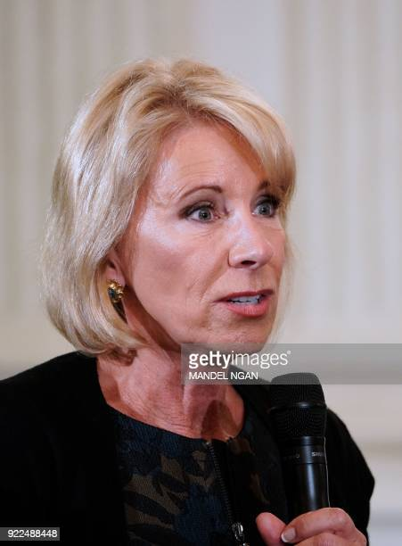US Education Secretary Betsy DeVos takes part in a listening session on gun violence with teachers and students in the State Dining Room of the White...