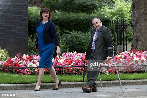 Education Secretary Nicky Morgan and Minister without portfolio Robert Halfon arrive to attend a Cabinet meeting at Downing Street on July 12 2016 in...