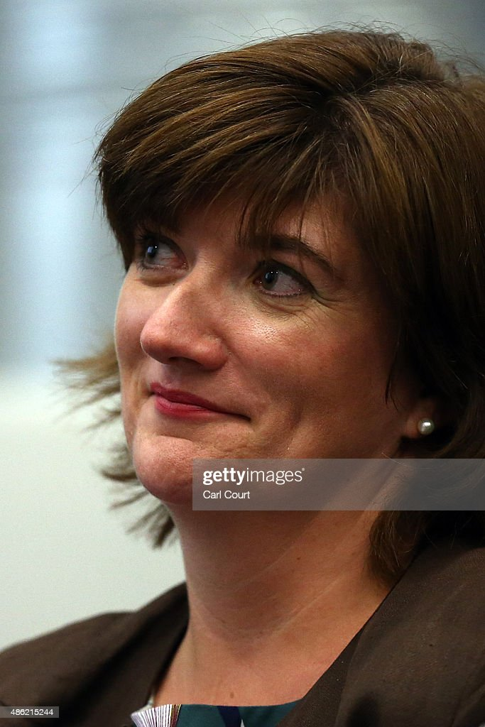 Education Secretary, Nicky Morgan, looks on as Prime Minister David Cameron addresses pupils at an assembly during a visit to Corby Technical School on September 2, 2015 in Corby, England. Mr Cameron used the visit to announce plans for another 18 free schools in England.
