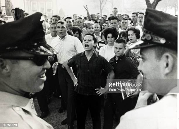 16th September 1963 Birmingham Alabama Policemen watch as white students jeer as two black girls are integrated into West End High School