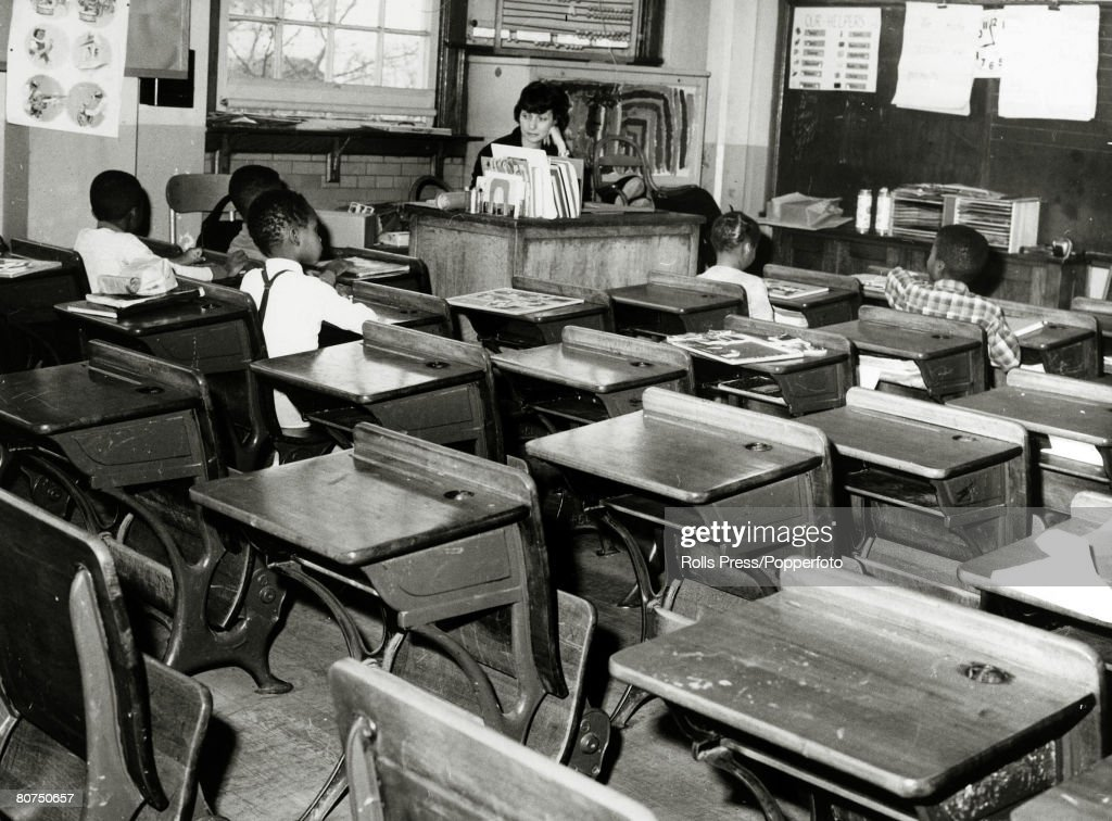 Education Segregation, USA. pic: 1964. Queens, New York. A near deserted classroom with just 5 black children attending, after a massive boycott by whites after the school had been included in the integration plan. : News Photo