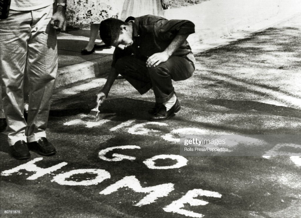 Education Segregation, USA. pic: September 1957. Winston-Salem, North Carolina. Racial abuse spread by whites is about to be removed, after angry whites had voiced their hatred after a black student had been allowed to study at R.J.Reynolds High School. : ニュース写真