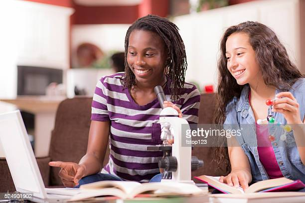 Education.  Teenage girls studying science at home. Homework.