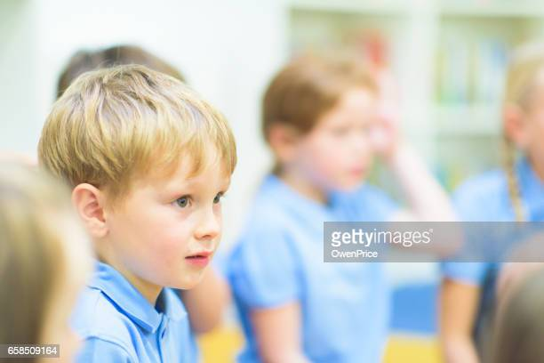 education uk primary school music lesson - school children stock photos and pictures