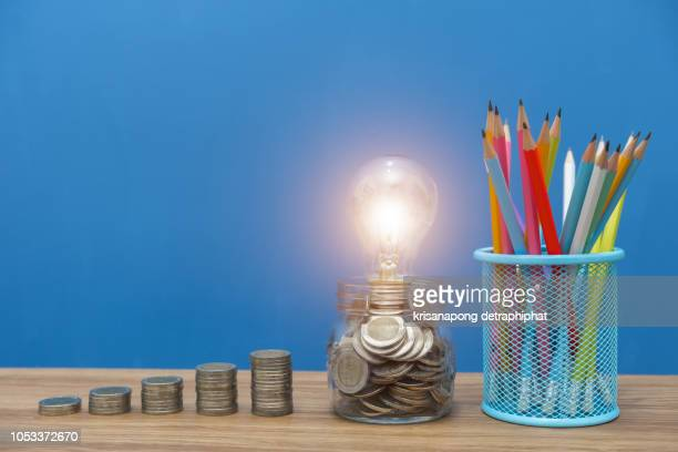 educational investment,education concept,school books on desk,idea concept, - stipendium stock-fotos und bilder