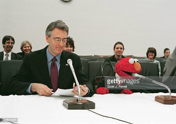 EDUCATIONJoe Lamond president and CEO of NAMMInternational Music Products Association testifies with Elmo the Muppet character from television's...