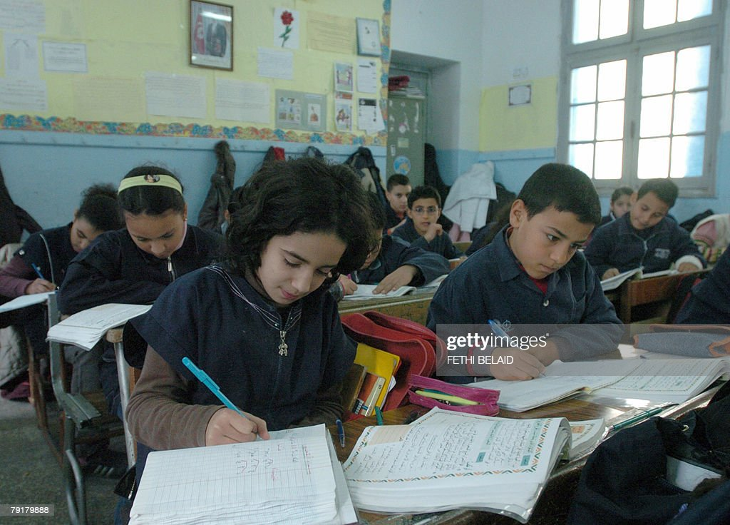 FRENCH 'Education-Maghreb-UN' Young Tunisian students write in their notebooks in the classrom of a primary school in Tunis 23 January 2008. According to a UN (United Nations) objective, Tunisia and Algeria should guarantee education for all by the year 2015.