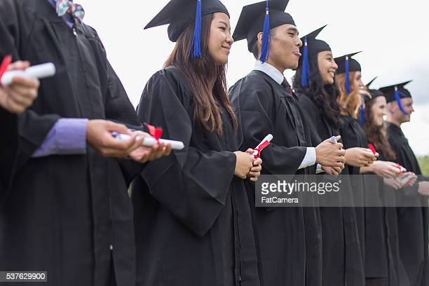 Educaton: Diverse group of college students graduating