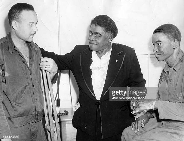 Educator and Civil Rights activist Mary McLeod Bethune and African American soldiers sitting and talking 1945