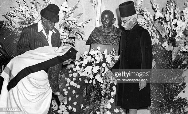 Educator and Civil Rights activist Mary McLeod Bethune and Hamid Ali placing flowers at the Department Auditorium during a memorial service for...
