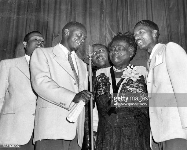 Educator and Civil Rights activist Mary McLeod Bethune and men singing on stage Virginia July 11 1945