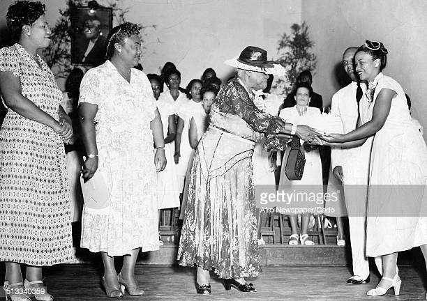 Educator and Civil Rights activist Mary McLeod Bethune and churchgoers shaking hands during a banquet January 14 1950