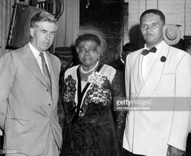 Educator and Civil Rights activist Mary McLeod Bethune and two men posing at Howard Theatre Washington DC July 21 1945