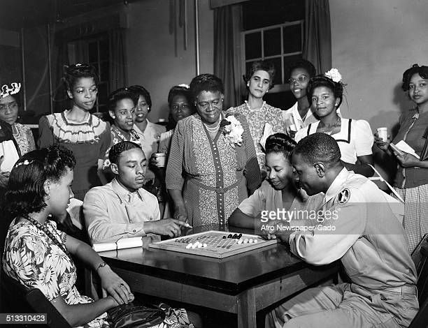 Educator and Civil Rights activist Mary McLeod Bethune and USO Junior Hostesses at the Young Womens Christian Association during World War 2...