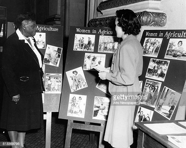 Educator and Civil Rights activist Mary McLeod Bethune and woman looking at a display on Women in Agriculture Washington DC December 1947