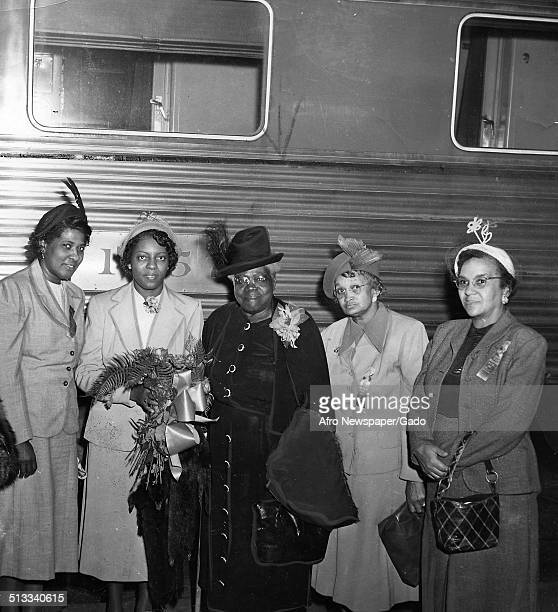 Educator and Civil Rights activist Mary McLeod Bethune and women with a train 1945