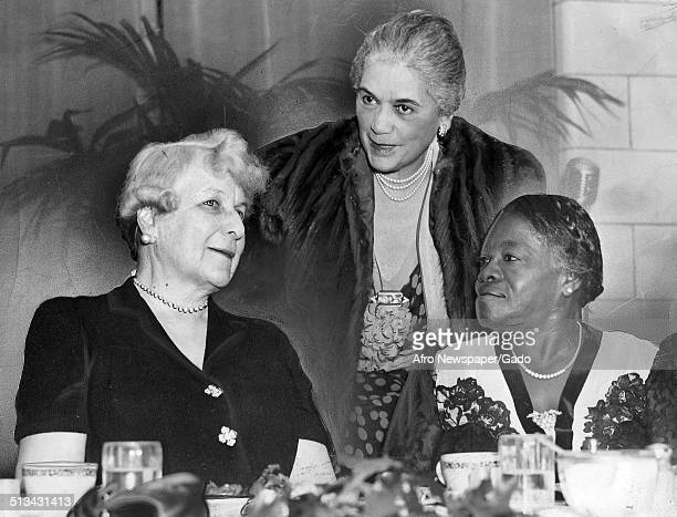 Educator and Civil Rights activist Mary McLeod Bethune conversing and sitting at a table during a banquet November 2 1940
