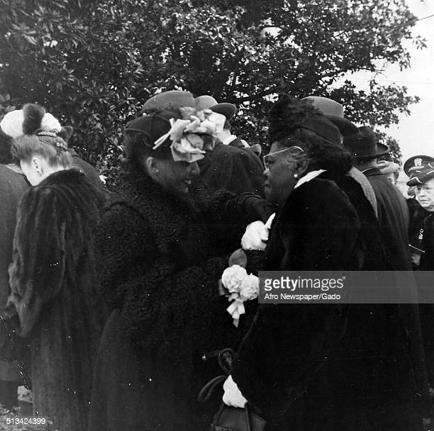 Educator and Civil Rights activist Mary McLeod Bethune conversing at a funeral 1945