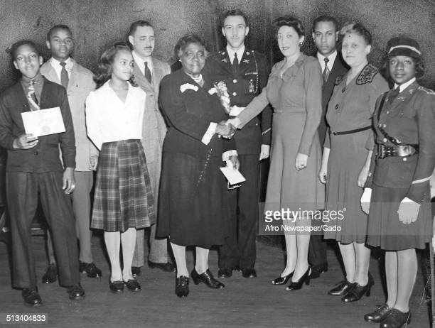Educator and Civil Rights activist Mary McLeod Bethune shaking hands March 10 1945